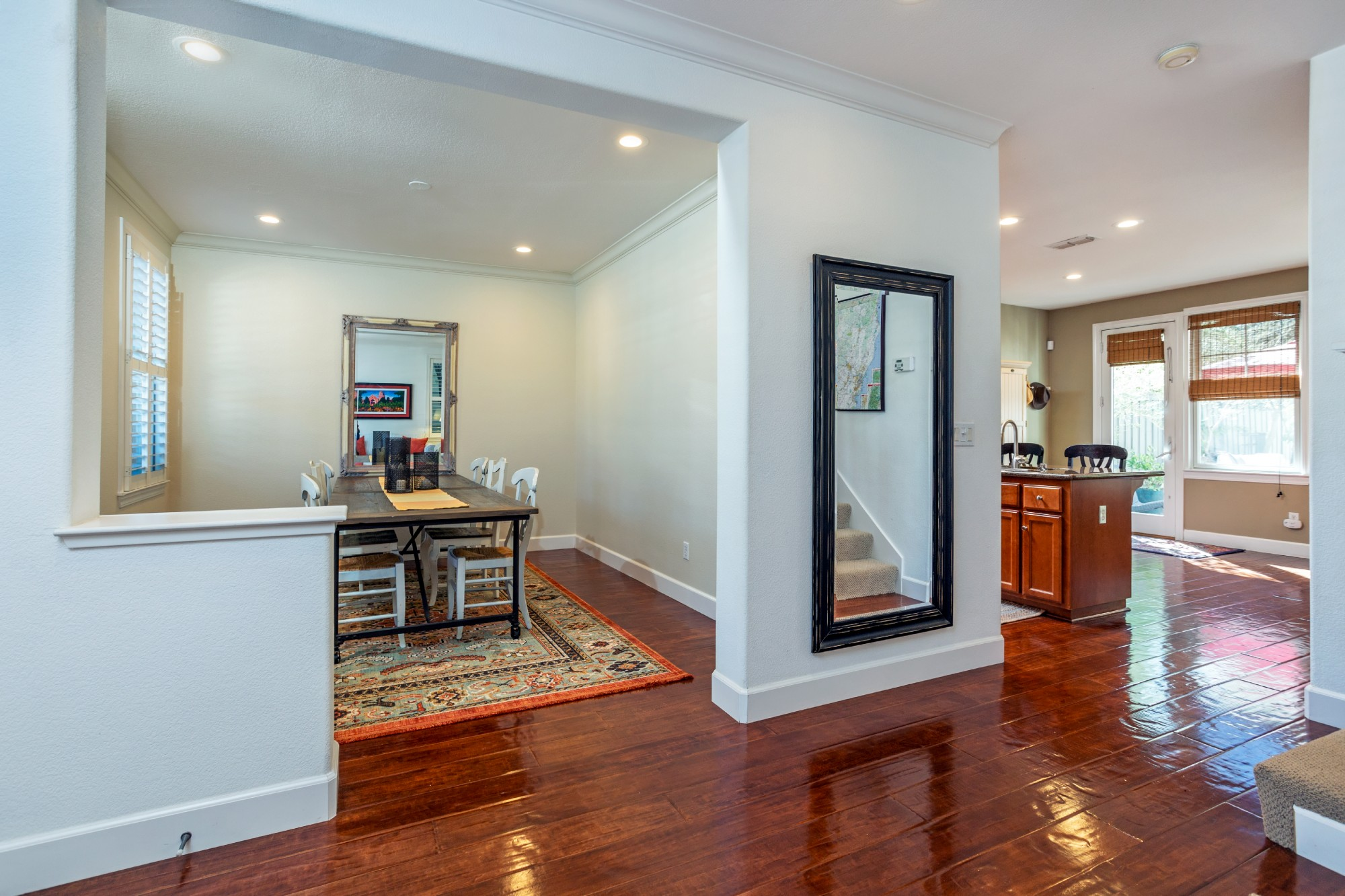 The gleaming wood floors lead into the formal part of the home, and there is a half-bath on this level as well