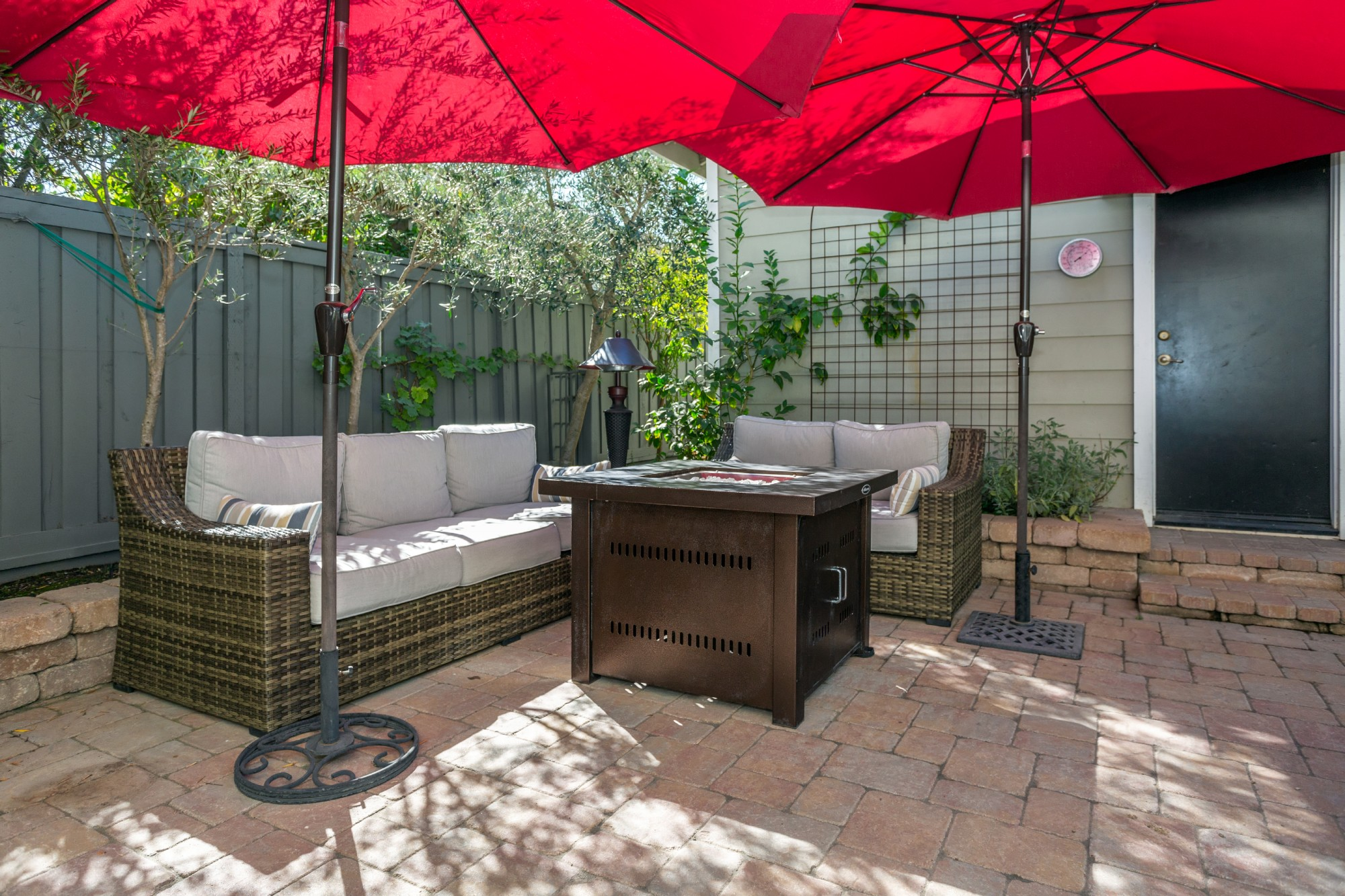 All outdoor furnishings are included, including the gas firepit